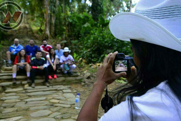 Indigenous Guide Photographing Travelers in the Lost City